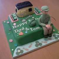 Fishing And Gardening Birthday Cake This is a joint birthday cake that I made. It is a maderia sponge cake decorated with fondant icing and homemade fondant figures. I made...