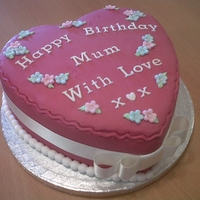 Mum Heart Birthday Cake This is a madeira sponge cake decorated with a fuschia fondant icing with a bow.