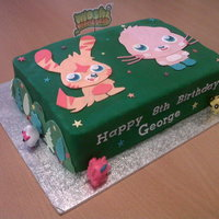 Moshi Monsters Birthday Cake This is a Maderia Cake that I decorated with fondant icing. I then before I made the cake, made the two Moshi Monsters Poppet and Katsuma...