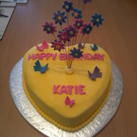 Exploding Flowers Birthday Cake This is a Maderia Cake that I decorated with fondant icing. I then created the exploding flowers and attatched them to 22 gauge wires. I...