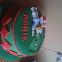 50Th Birthday Cake First attempt at a golf cake . The birthday girl loved it . Fondant icing , gumpaset golf bag and player