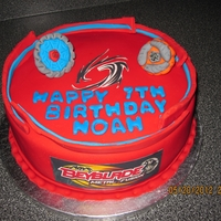 Beyblade Arena Cake   Beyblades made out of fondant and cake is 10 inch double layer all decorated in fondant