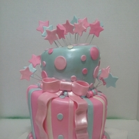 Stars Two-tiered topsy turvy cake. Vanilla cake with buttercream frosting, covered in fondant and air brushed with pearl dust. one of my...