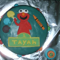 Baby's 1St Birthday With Elmo It's a Birthday cake with Elmo holding balloons for my little girls 1st birthday. The cake was chocolate with chocolate moose filling...