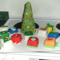 Merry Christmas The Christmas tree is RC treats with MM fondant accents. Each present is chocolate cake with chocolate moose filling. I decorated each cake...