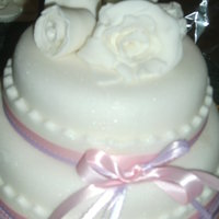 2 Tier Wedding Cake White round wedding cake, with BC filling. Covered in fondont. Rose are made out of fondant too. I put pink and purple sweet williams on...