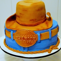 "Charlies Cowboy Cake 10"" Round White chocolate cake with chocolate ganacheHat was carved from a 6"" Round Chocolate cake with chocolate ganache. Belt..."