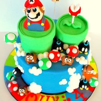 Mario Time!! Olly's Mario Cake A Cake I made for my nephew last week to say it politely he is OBSESSED with Mario. He loved his cake and spent the...