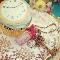 'dont Be Late' Carrot Cupcakes carrot cupcakes with cream cheese frosting and fondant clock.I also made the necklaces - they formed the favours for my tea party (Mad...