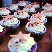 Red Velvet Star Cupcakes   topped with golden stars!