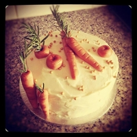 24 Karat Cake (Again) Decorated with marzipan carrots which i brushed with petal dust to give a more realistic look :)