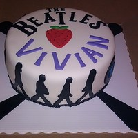 The Beatles A friend asked me to make a similar beatles cake to the one I had done before, I didnt want to copy it exactly so I came up with this. Dark...