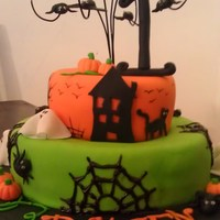Halloween 1St Birthday  All fondant decor. Hand made edible spiders, ghosts, pumpkins,bats etc. Hand painted trees, fences, birdies. Iced spider webs. Florist wire...