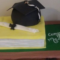Grad Cake For Education Book and hat are dominican cake with cream filling. Butter cream icing and fondant.