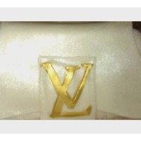 Lv Clutch Cake  LV Clutch all made of fondant. Hand carved logo and hand painted with Gold luster dust/spray paint. Purse was brushed with pearl luster...