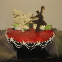Sweet Dance Dominican cake, with italian frosting, royal icing and Orance fondant, figures are made of chocolate