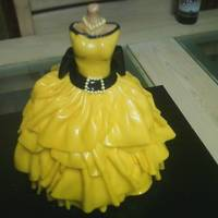 Yellow Quinceanera Tres leches cakes, filled with strawberry and decorated with fondant.