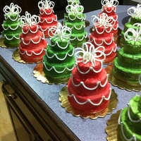 "Mini Christmas Cakes I made these 4"" cakes for Christmas gifts. Used my mini tiered cake mold pan to do. Accents are fondant"