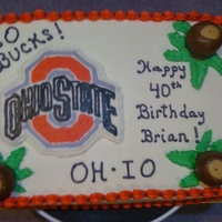Ohio State Buckeye Cake   White cake with buttercream. Logo is FBCT. Peanut butter and chocolate buckeyes