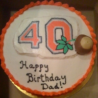 40Th Birthday Buckeye Fan White cake with buttercream icing. Logo is FBCT and a Buckeye candy for accent