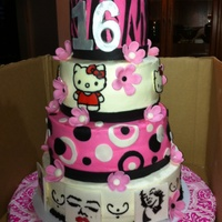 Sweet 16 With Hello Kitty And Marilyn Monroe Birthday girl wanted a cake with Hello Kitty and Marilyn Monroe. Made fondant tiles where my daughter painted the Marilyn Monroe pictures...