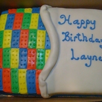 Lego Birthday Cake White cake with MMF. Cut out lego blocks and pieced in. Used a round icing tip to cut out the dots for tops of each piece -- very time...