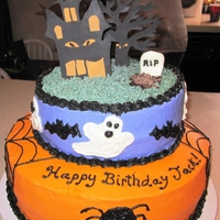 Halloween Birthday Cake Chocolate cake with buttercream. The tree, haunted house and tombstone are fondant