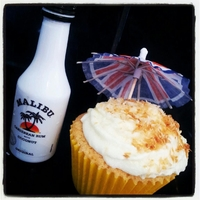 Coconut Rum Cupcakes Coconut cupcake topped with malibu infused buttercream, coconut and topped with toasted coconut.