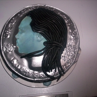 Coin Cake THIS WAS A UNIQUE CAKE. MY CLIENT WAS TURNING 25, SO I DECIDED TO IMAKE HIS FACE ONTO A QUARTER. HE WAS BLOWN AWAY