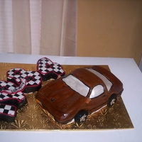 1984 Corvette CLASSIC 1984 CORVETTE CAKE. HAND CARVED, I DECIDED TO CARVE THE CAR'S YEAR FROM CAKE AND DECORATE IT LIKE A CHECKERED FLAG