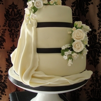 3 Tier Wedding Cake With Sugar Flowers And Sugar Drape