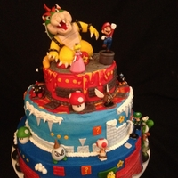 Mario World Birthday Bowser, mushrooms, iceball, & spikebombs are fondant...other figures are toys requested by friend.