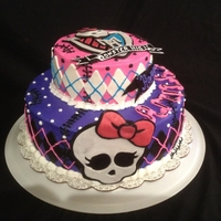 "Monster High Cake Made this Monster High Cake for friends niece 7th birthday...2 tier strawberry cake iced with buttercream...""skullette"" banner,..."