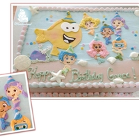 Bubble Guppies Cake All buttercream cake with hand made bubble guppies...I painted their faces by hand..hope you guys like it.