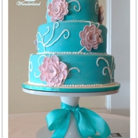 Blue And Pink Blue and pink cake with gumpaste flowers and piping.