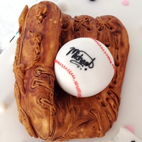 Baseball Glove! I sculpt this cake then coverd in fondant..hand painted to give a real look.. The baseball is made out of white chocolate.