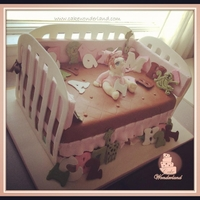 Baby Crib Cake Baby crib cake...I used gumpaste for the walls and color flow for the letters and animals.. I free hand the little Baby girl.