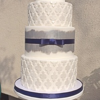 Moroccan Lattice With Silver Painting And A Navy Bow Moroccan lattice with silver painting and a navy bow.