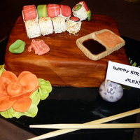 "Sushi Birthday Cake Made this for my sushi-loving boyfriend's birthday. ""Wood"" board is the cake, covered in fondant and brushed with vanilla..."