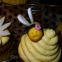 Bee Baby Shower Cupcakes Banana cupcakes with honey-vanilla buttercream bee hives, and fondant bees and daisies.