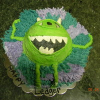 "Monsters Inc.   12 "" hex base with half ball for mike. # 17 fur on base. all butter cream."