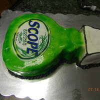 Bottle Of Scope label was drawn onto icing sheet and cut out. mmf covered and airbrushed with butter cream trim.