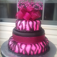 Pink & Black Zebra Print  I made this for a little girl's 1st birthday. There were two layers of white cake and one layer of chocolate; each filled with...