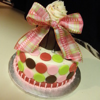 Cupcake Cake Fondant covered rice krispy cupcake, buttercream frosted cake.... sprinkled with a big bow!!!