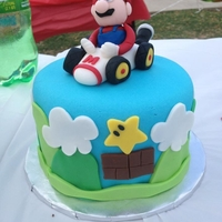 Mario Mario Kart cake and Mario themed cupcakes. All decorations are fondant.