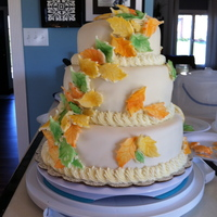 Fall Leaves 3 Tier   This is a 3 tier WASC cake with almond buttercream and white chocolate fondant and fondant leaves