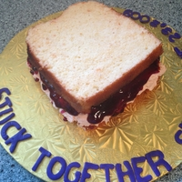 "Peanut Butter And Jelly Cake Peanut Butter and Jelly Cake with real peanut buttercreme filling and real Jelly. It reads, ""Stuck Together since June 23, 2009&quot..."
