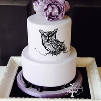 Midnight Owl A simple hand-painted owl on a two tiered chocolate cake with lavender infused creme anglaise buttercream and chocolate ganache.