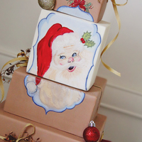 Vintage Joy Vintage Santa hand painted on square tiers made to look like presents wrapped in brown paper. Made for the Half Baked Cake blog. See more...