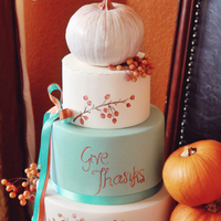 Turquoise And Orange Thanksgiving Cake Topped With A Hand Painted Pumpkins And Crab Apples Turquoise and orange Thanksgiving cake topped with a hand painted pumpkins and crab apples.